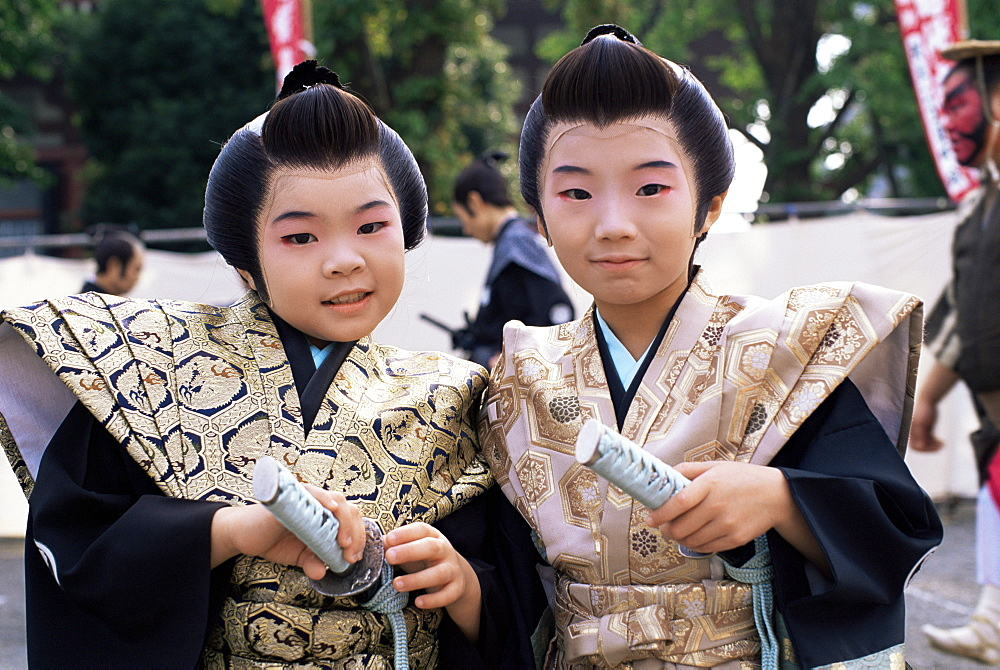 Two boys dressed in Samurai costume at Jidai Matsuri Festival held annually in November at Sensoji Temple Asakusa, Tokyo, Honshu, Japan, Asia