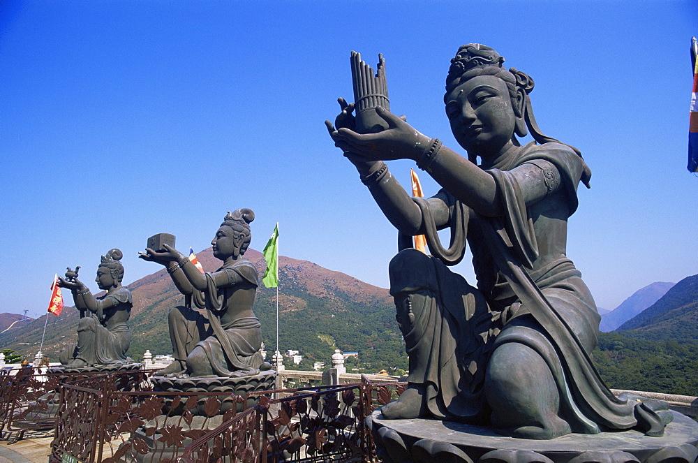 Chinese goddess statues at the base of the Giant Buddha Statue at Po Lin Monastery, Lantau, Hong Kong, China, Asia