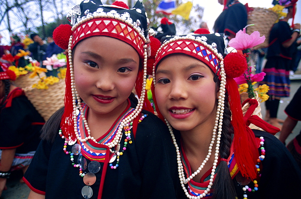 Akha hilltribe girls wearing traditional dress, Chiang Rai, Golden Triangle, Thailand, Southeast Asia, Asia