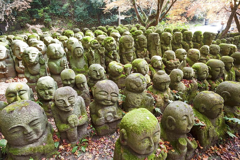 Carved stone figures of Rakan, disciples of Shaka the founder of Buddhism, Otagi Nembutsu-ji Temple, Arashiyama, Kyoto, Japan, Asia - 834-6556