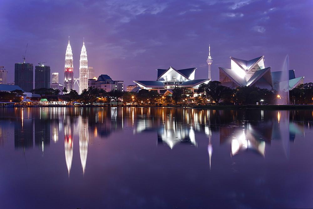 The remarkable Kuala Lumpur skyline, reflected in a lake at Titiwangsa in Kuala Lumpur, Malaysia, Southeast Asia, Asia - 835-113