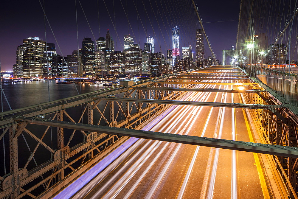 Traffic leaves colourful trails along the Brooklyn Bridge in New York, New York State, United States of America, North  America - 835-115