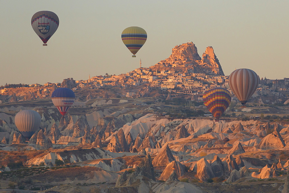 Hot air balloons rising into the dawn sky above Goreme, Cappadocia, Anatolia, Turkey, Asia Minor, Eurasia
