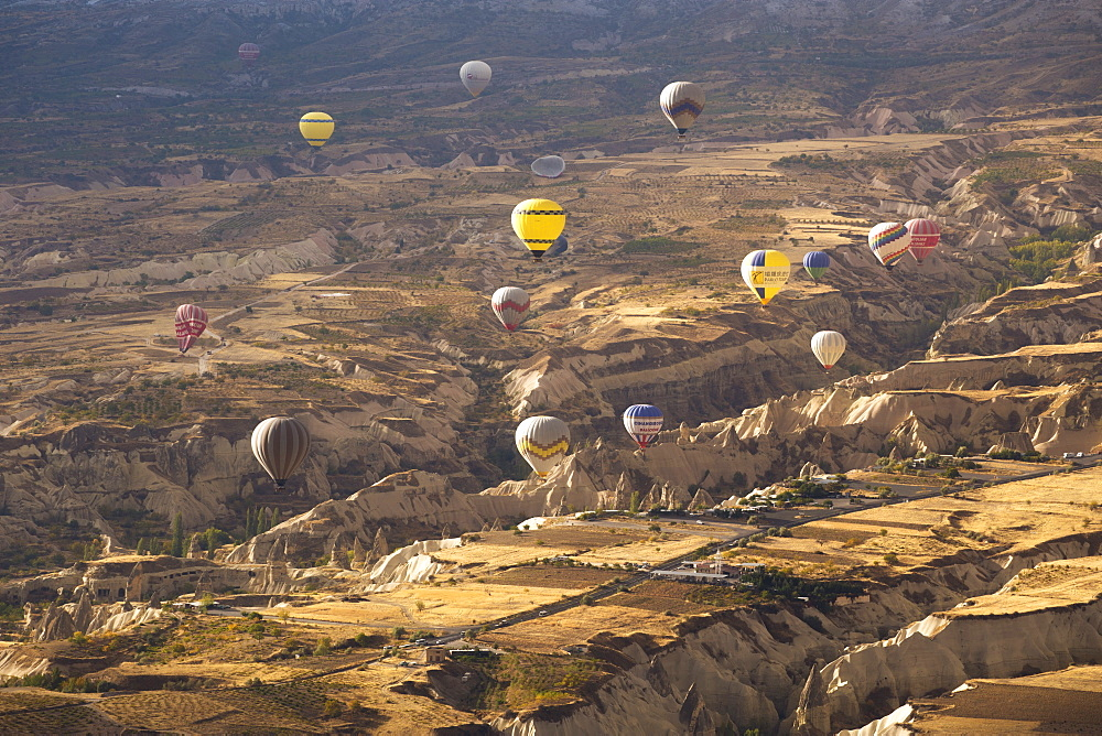 Hot air balloons above the volcanic landscape near Goreme, Cappadocia, Anatolia, Turkey, Asia Minor, Eurasia - 835-82