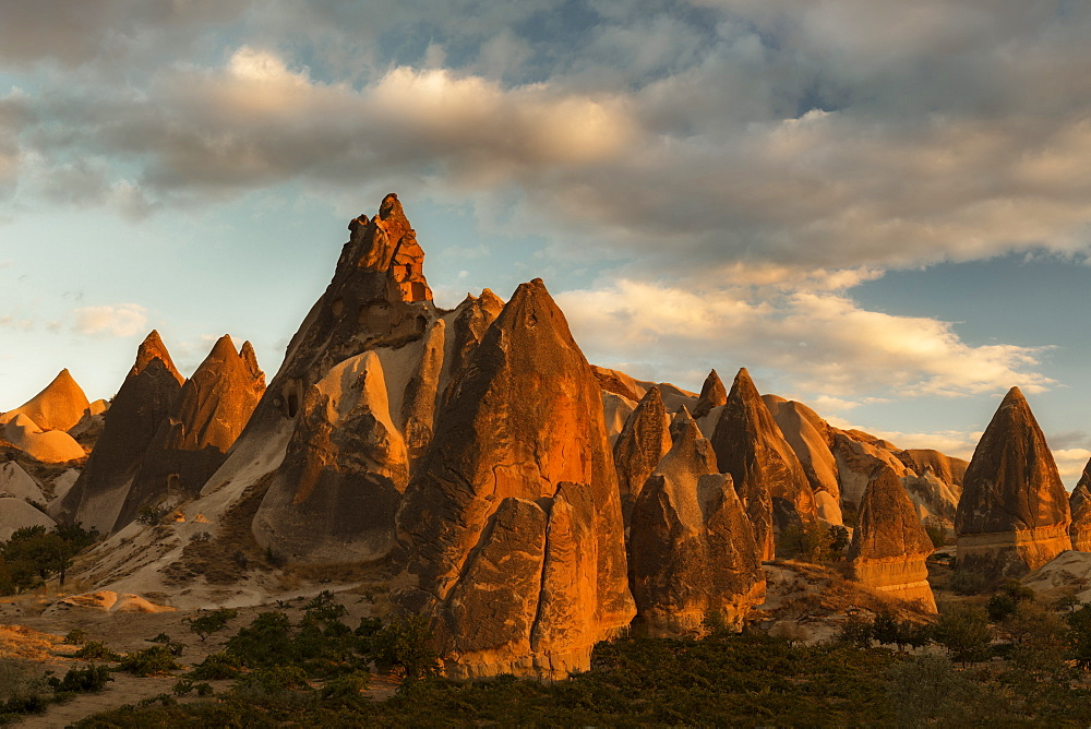 Volcanic desert landscape and its fabulous geographical structures caught in evening light, Goreme, Cappadocia, Anatolia, Turkey, Asia Minor, Eurasia