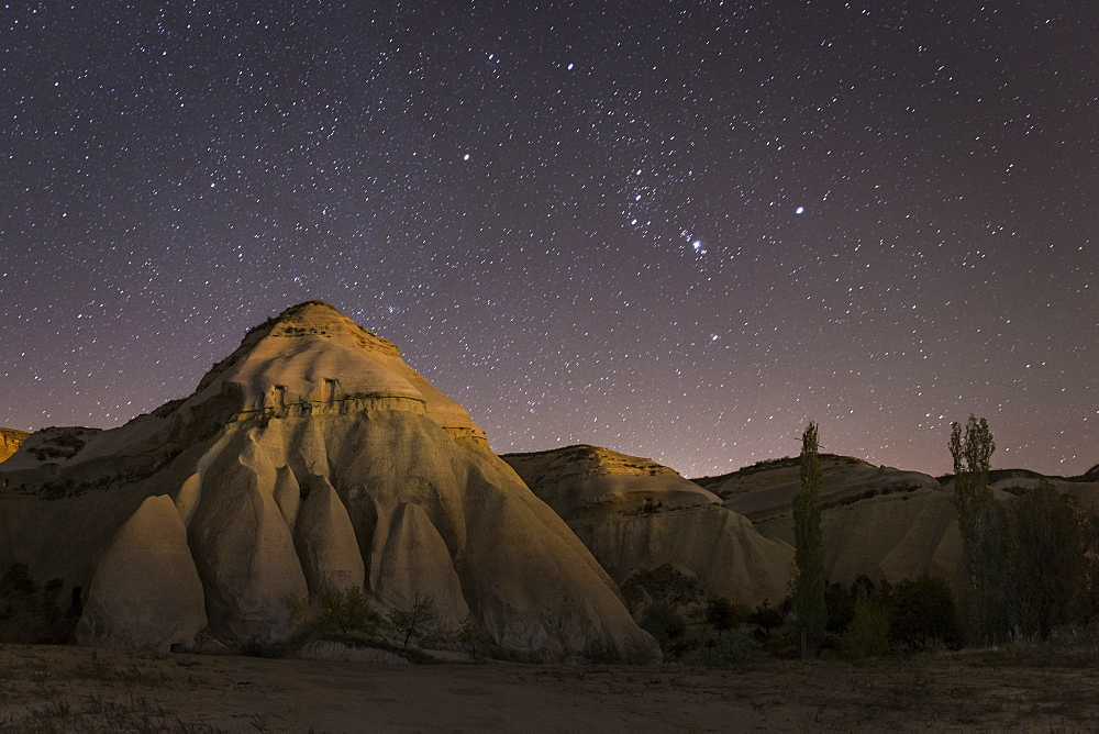 Night time in the Rose Valley showing the rock formations and desert landscape light painted with torches, Cappadocia, Anatolia, Turkey, Asia Minor, Eurasia - 835-87