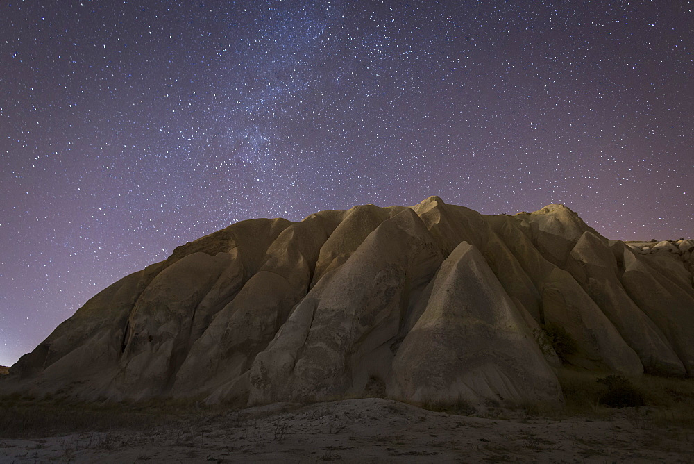 Night time in the Rose Valley showing the rock formations and desert landscape light painted with torches, Cappadocia, Anatolia, Turkey, Asia Minor, Eurasia
