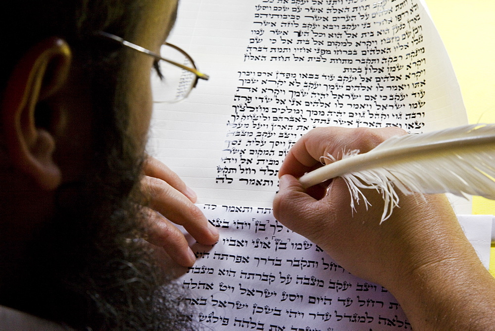 Photograph of an Orthodox Jew doing the work of copyist of the scriptures, Israel