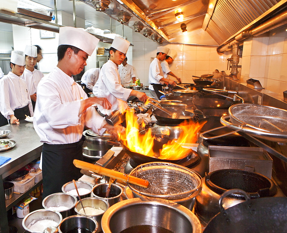 Chefs preparing Chinese cuisine in woks in the modern kitchen of a Chinese restaurant, Beijing, China, Asia - 839-18