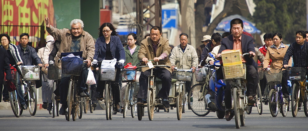 Chinese commuters riding bicycles on a city street, Beijing, China, Asia - 839-2