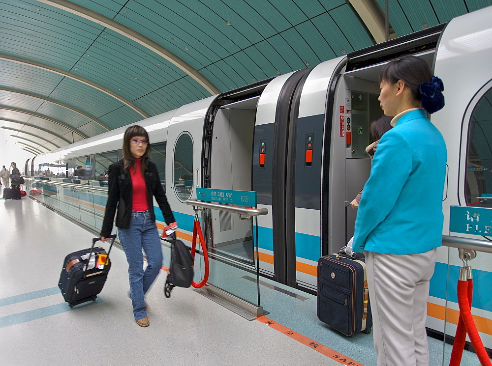 Passenger boarding magnetic levitation high speed train on a Shanghai station platform, Shanghai, China, Asia - 839-22