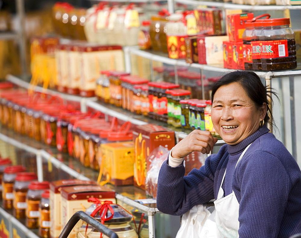 Chinese female street vendor selling packaged food and gift products, Chengdu, Sichuan, China, Asia - 839-32