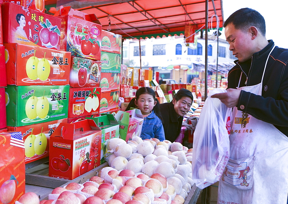 A Chinese small family business selling fruit in colorful gift boxes during the Chinese New Year holiday, Chengdu, Sichuan, China, Asia