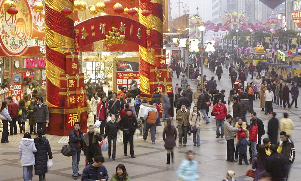Shoppers fill a mall downtown during the traditional Chinese New Year Spring Festival, Chengdu, Sichuan, China, Asia - 839-42