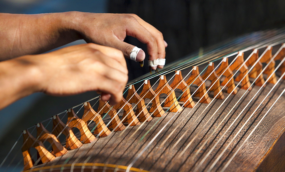 Closeup of two hands playing the guzheng, a traditional Chinese string instrument, Beijing, China, Asia - 839-43