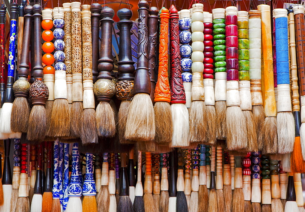 Chinese calligraphy brushes with colorful handcarved handles of stone and wood, Beijing, China, Asia