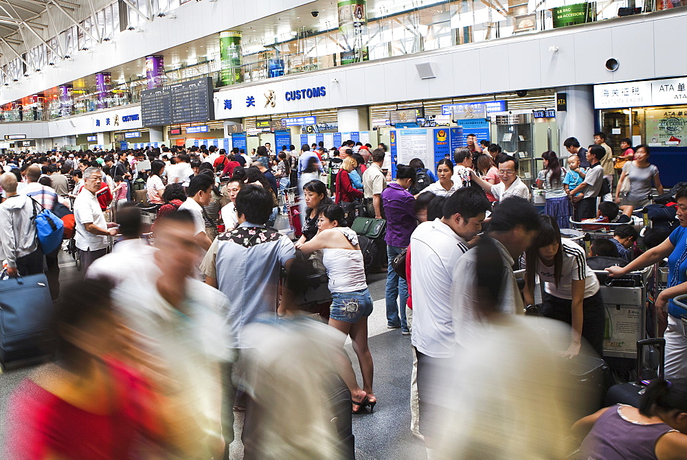 Chinese airline passengers lined up at the Beijing Capital Airport, Beijing, China, Asia - 839-9