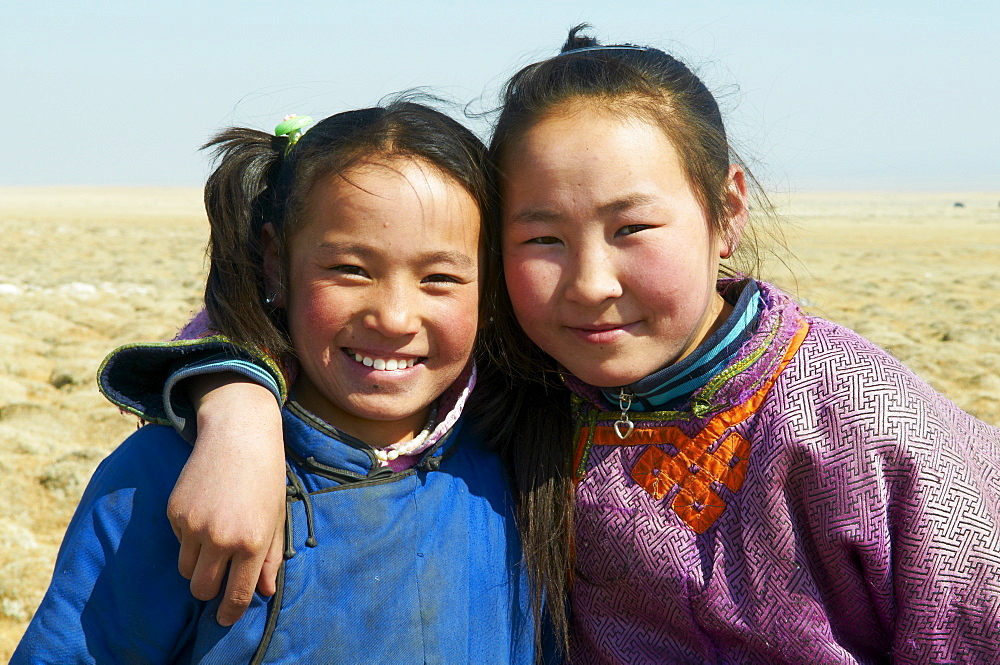 Young Mongolian girls in traditional costume (deel), Province of Khovd, Mongolia, Central Asia, Asia