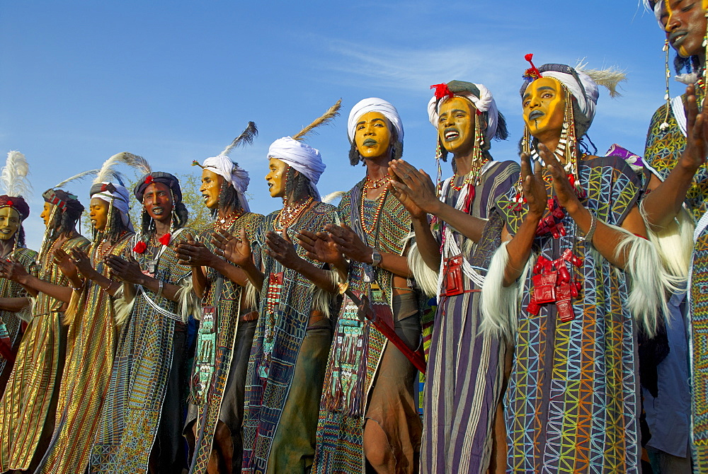 Group of Wodaabe (Bororo) men with faces painted for the annual Gerewol male beauty contest, the general reunion of West Africa for the Wodaabe Peul (Bororo Peul) people, Niger, West Africa, Africa - 841-421
