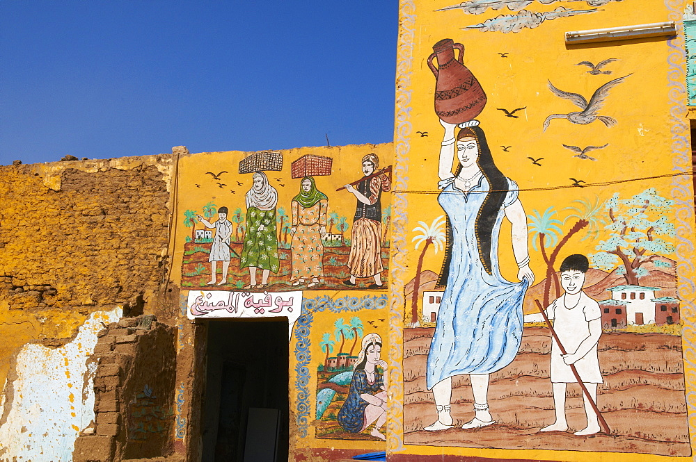 Wall paintings on house in the village of Gourna El Gedida, West Bank of the River Nile, Thebes, Egypt, North Africa, Africa