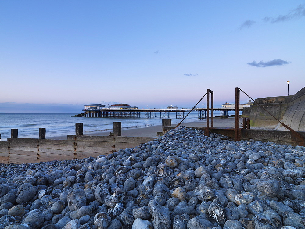 A twilight view of the beach and pier at Cromer, Norfolk, England, United Kingdom, Europe