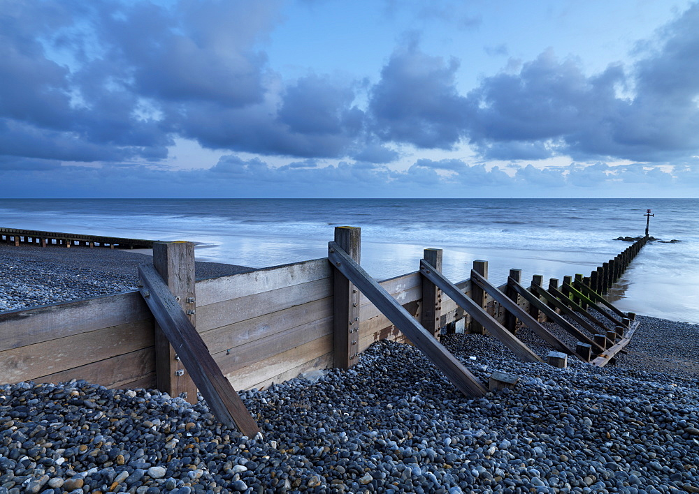 Sea defenses on the pebbly beach at Sheringham, Norfolk, England, United Kingdom, Europe