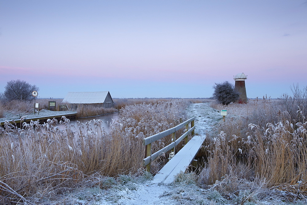 A frosty morning in the Norfolk Broads showing the mill and staithe at West Somerton, Norfolk, England, United Kingdom, Europe