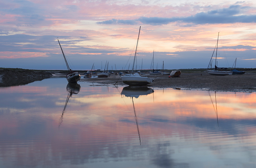 A beautiful sunset at low tide at Brancaster Staithe, Norfolk, England, United Kingdom, Europe