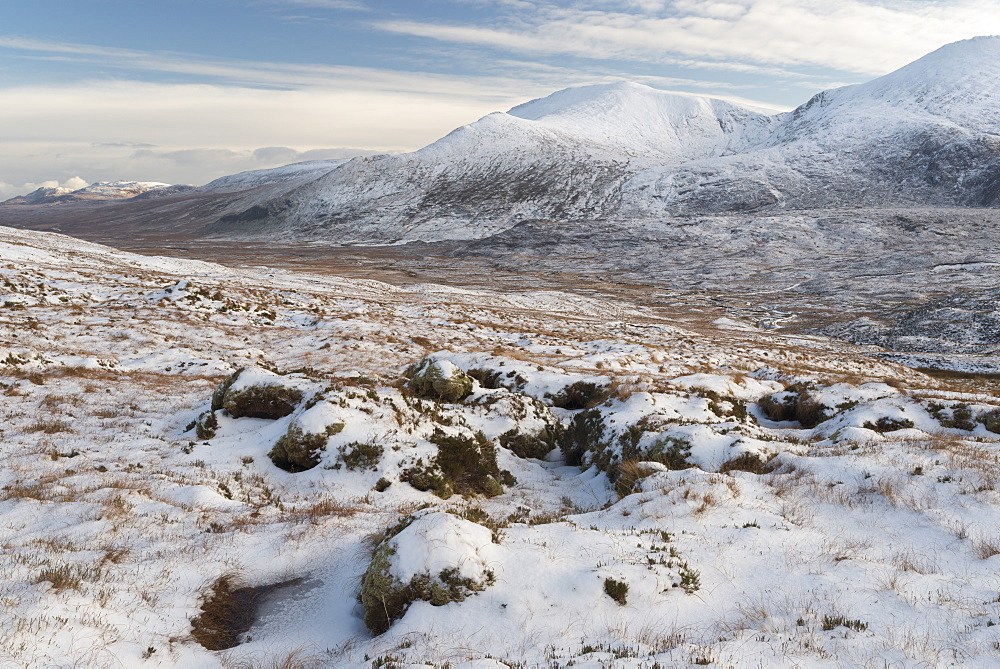 A winter view of the Sutherland mountains Beinn Spionnaidh and Cranstackie, Sutherland, Scotland, United Kingdom, Europe - 842-507