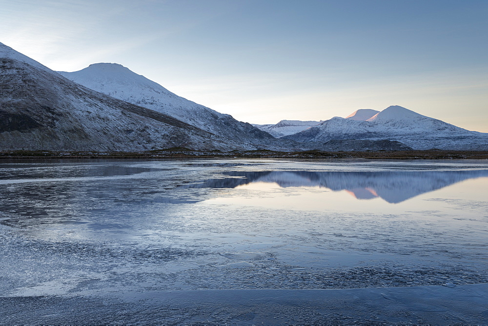 A view of the mountains of Cranstackie and Foinaven from a small lochan near Carbreck, Sutherland, Scotland, United Kingdom, Europe - 842-508