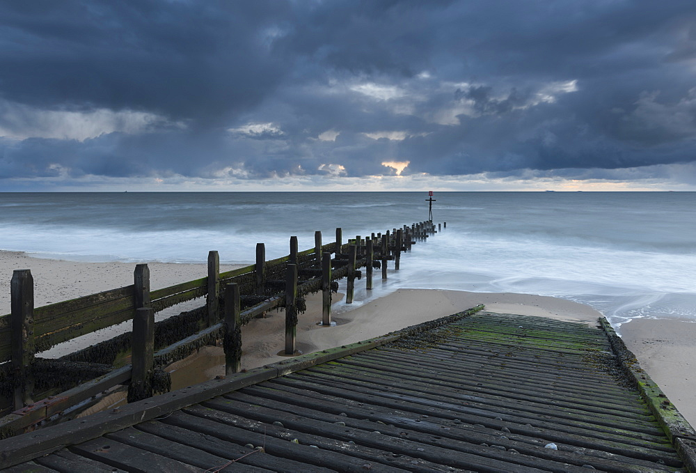 A slipway and groynes on the beach at Walcott, Norfolk, England, United Kingdom, Europe