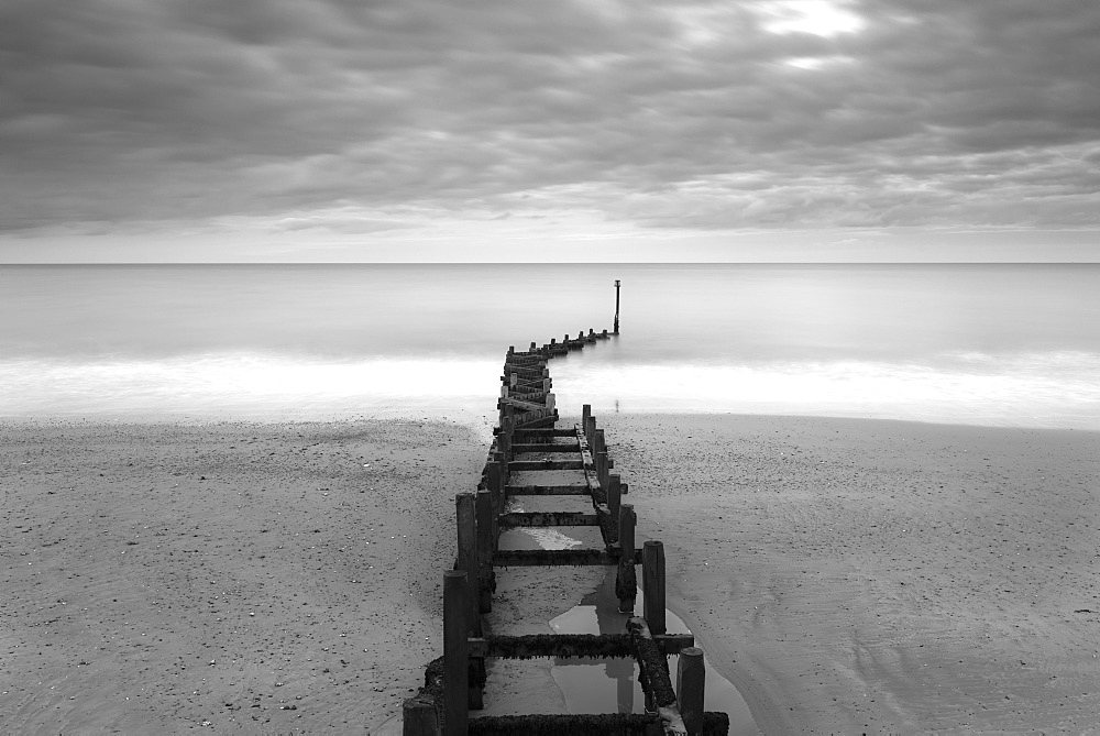 Sea defences on a moody day at Overstrand, Norfolk, England, United Kingdom, Europe