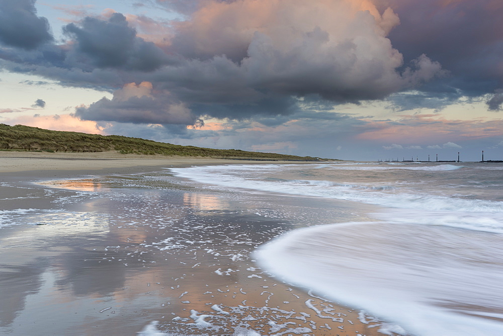 A beautiful cloudscape and wild sea at Waxham, Norfolk, England, United Kingdom, Europe - 842-569
