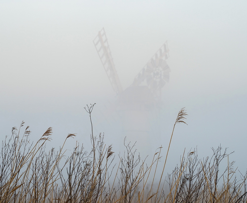 Thurne Mill viewed through the mist at Thurne, Norfolk, England, United Kingdom, Europe