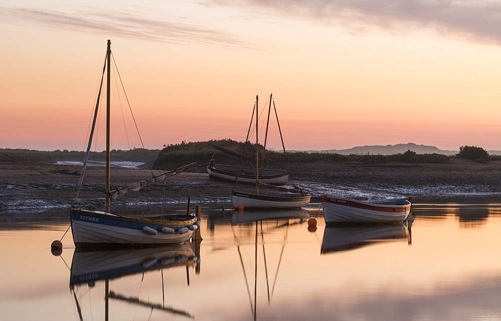Boats in the channel on a beautiful morning at Burnham Overy Staithe, Norfolk, England, United Kingdom, Europe