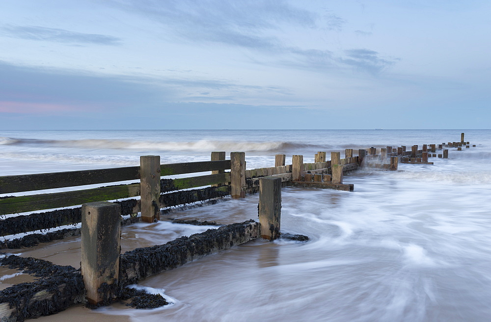 Incoming waves hitting a groyne at Walcott, Norfolk, England, United Kingdom, Europe