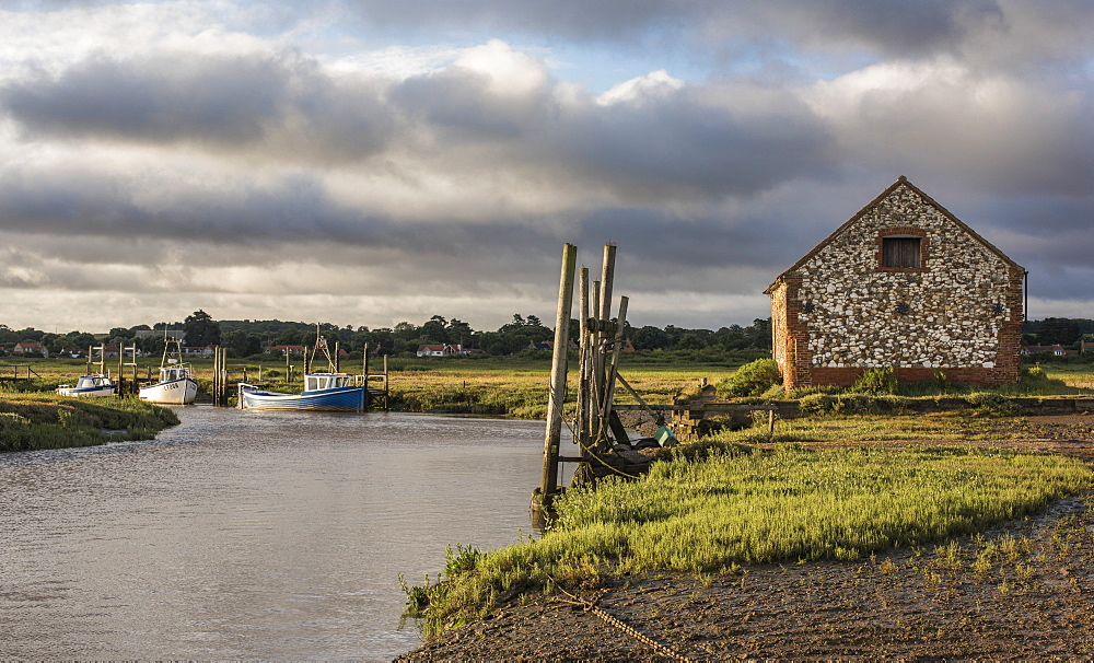 A view of boats moored in the creek at Thornham, Norfolk, England, United Kingdom, Europe - 842-577