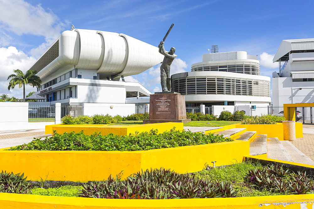 Garfield Sobers statue and The Kensington Oval Cricket Ground, Bridgetown, St. Michael, Barbados, West Indies, Caribbean, Central America