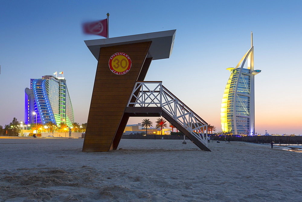 Burj Al Arab Hotel, sunset and lifeguard watchtower on Jumeirah Beach, Dubai, United Arab Emirates, Middle East