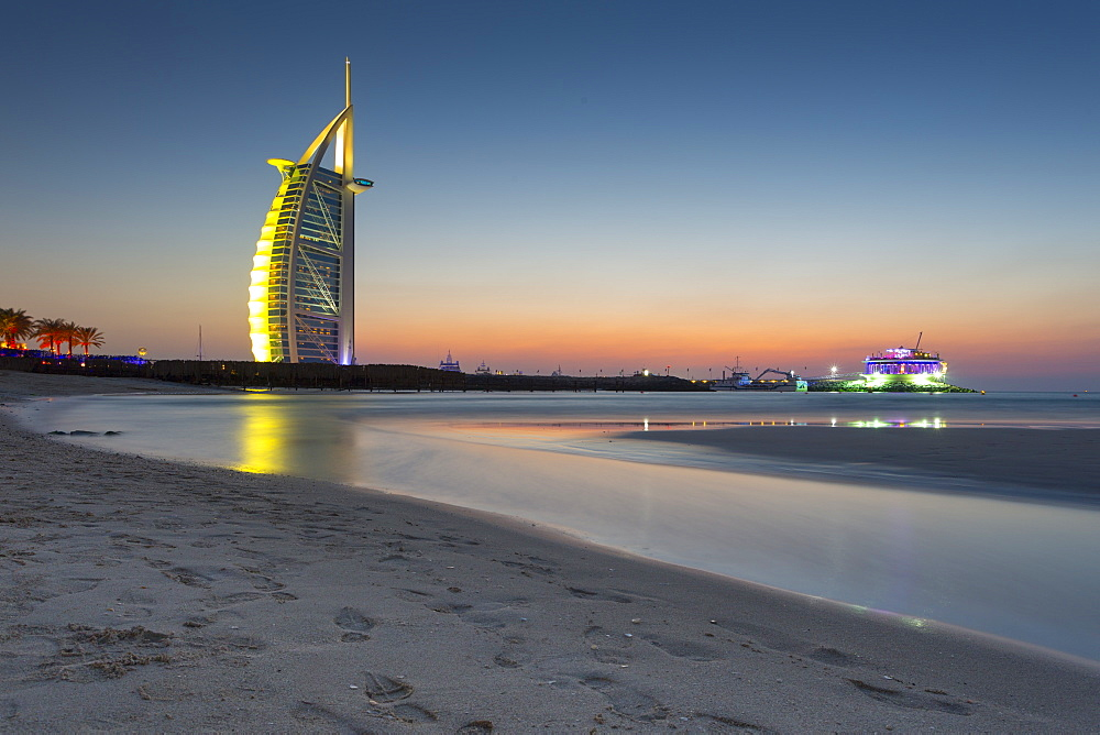 Burj Al Arab Hotel after sunset on Jumeirah Beach, Dubai, United Arab Emirates, Middle East