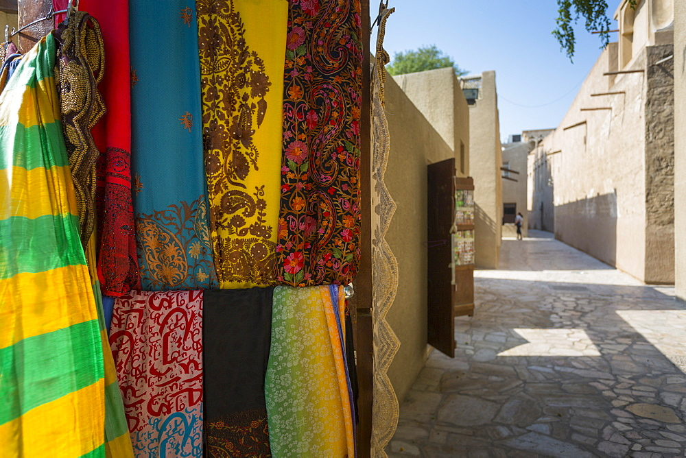 Narrow street and fabric shop in Al Fahidi Historical Centre, Bur Dubai, Dubai, United Arab Emirates, Middle East