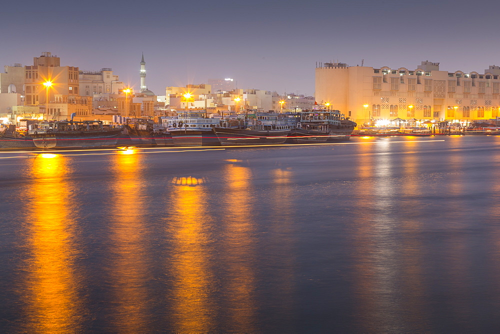 Boats on Dubai Creek at dusk, Bur Dubai, Dubai, United Arab Emirates, Middle East