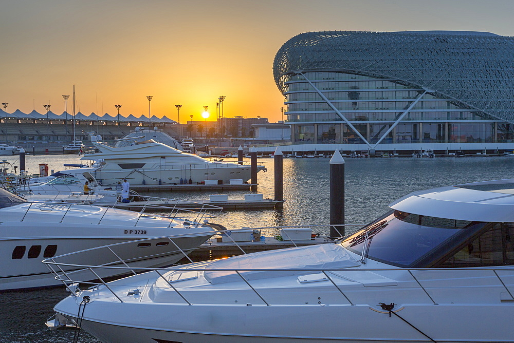 The Yas Viceroy Hotel and Yas Marina at sunset, Yas Island, Abu Dhabi, United Arab Emirates, Middle East