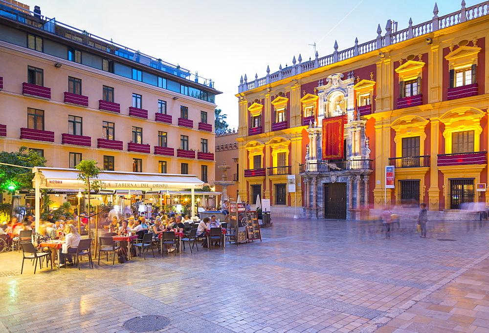View of restaurants in Plaza del Obispo at dusk, Malaga, Costa del Sol, Andalusia, Spain, Europe