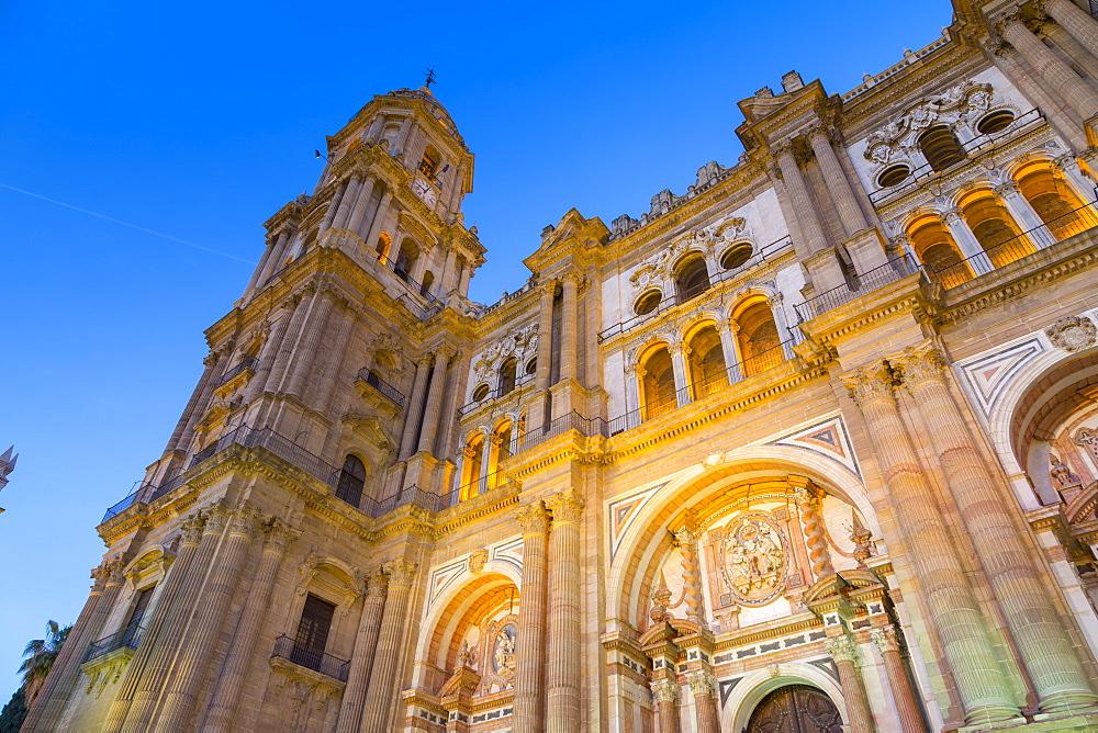 View of Cathedral in Plaza del Obispo at dusk, Malaga, Costa del Sol, Andalusia, Spain, Europe