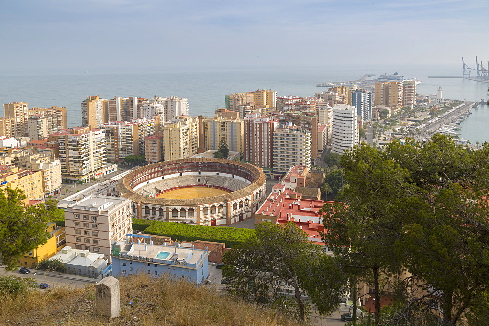 View of Plaze de Toros and harbour from the ruins of the Moorish castle fortress high atop Mount Gibralfaro, Malaga, Costa del Sol, Andalusia, Spain, Europe