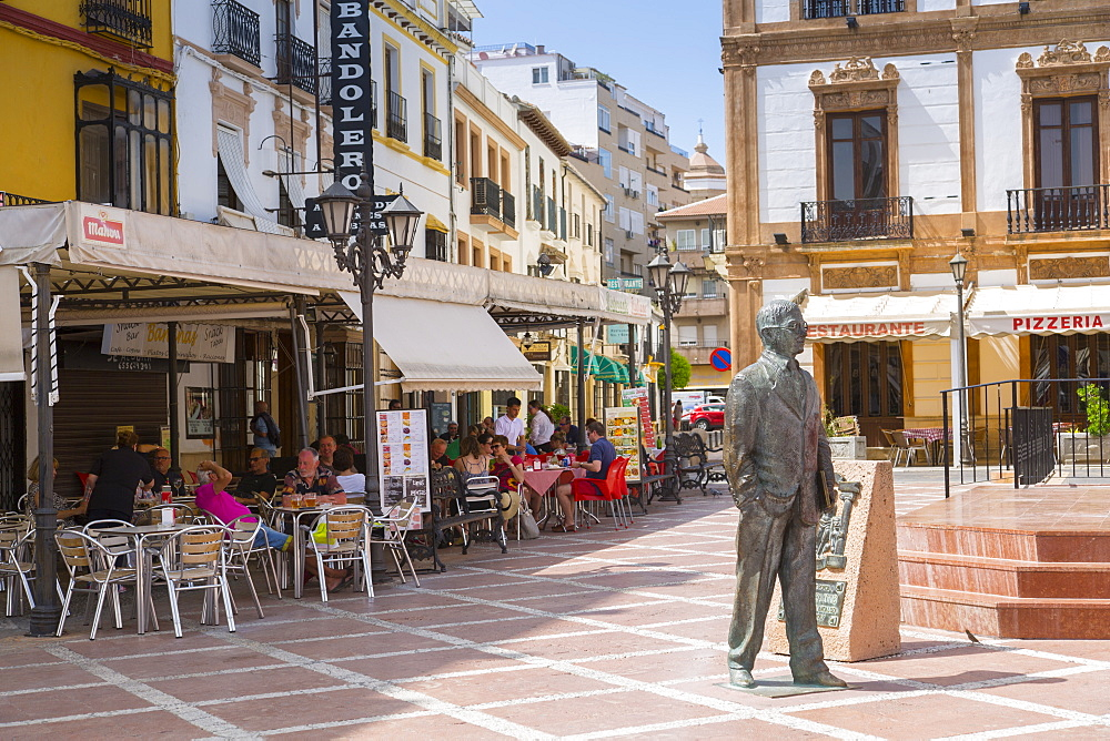 View of statue and restaurants, Plaza del Socorro, Ronda, Andalusia, Spain, Europe