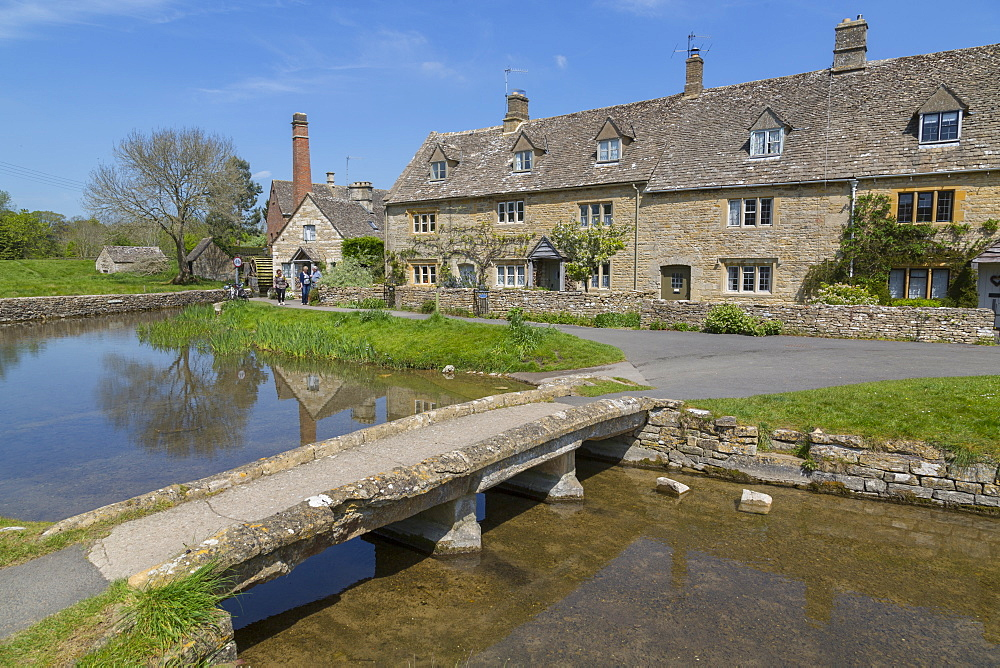 Cottages, Old MIll Museum and bridge over the River Eye in Lower Slaughter, Cotswolds, Gloucestershire, England, United Kingdom, Europe