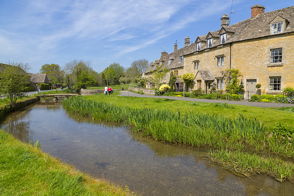 Cottages and footbridge over the River Eye in Lower Slaughter, Cotswolds, Gloucestershire, England, UK, Europe - 844-12766
