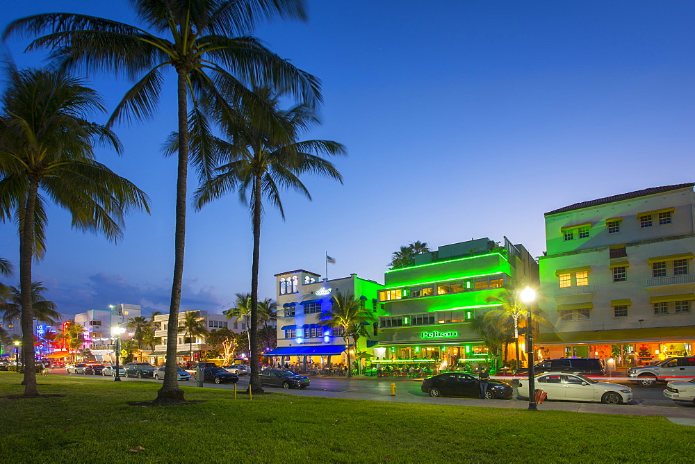 Ocean Drive restaurants and Art Deco architecture at dusk, South Beach, Miami Beach, Miami, Florida, United States of America, North America